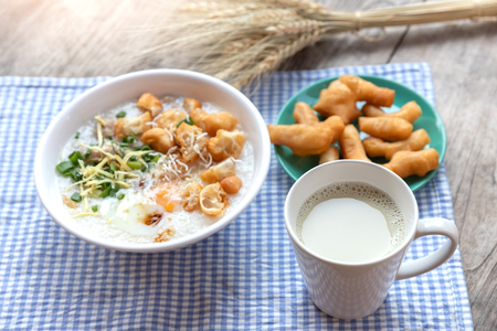 Breakfase meal. Congee or Rice porridge minced pork, boiled egg with soy milk and Chinese deep fried double dough stick