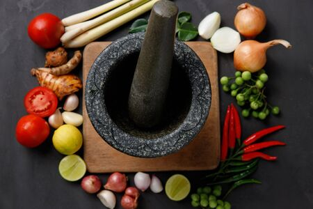 Thai kitchen. Various herbs, spices  and Ingredients on dark background. Top view with copy space