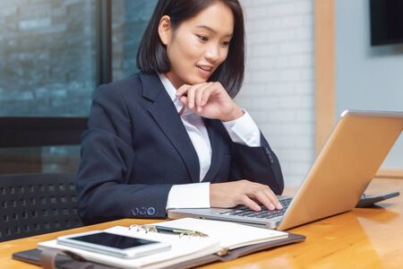 Business woman working with calculator in cafe.