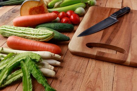 Thai kitchen. Various vegetables, spices  and Ingredients with knife and chopping board