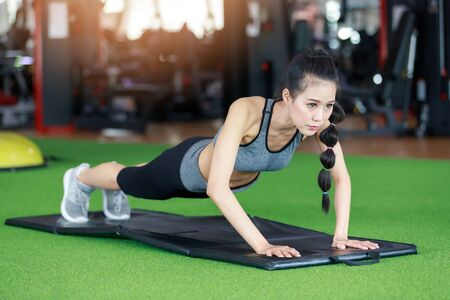 Fitness woman cardio workout at fitness gym.