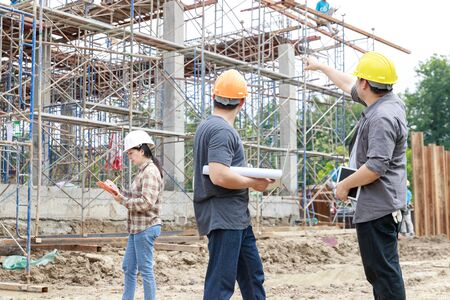 Construction concept of Engineer and Architect working at Construction Site with blue print Stock Photo