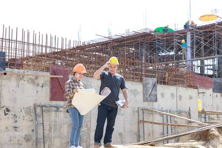 Construction concept of Engineer and Architect working at Construction Site with blue print 版權商用圖片