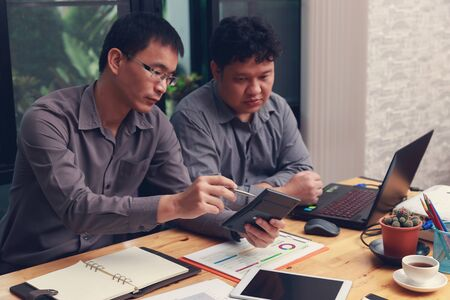 Small and Medium Enterprise Business concept of  ,Businessmans discussing investment plan in office.