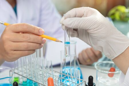 Research and development concept, Laboratory scientist working at lab with test tubes about medicine