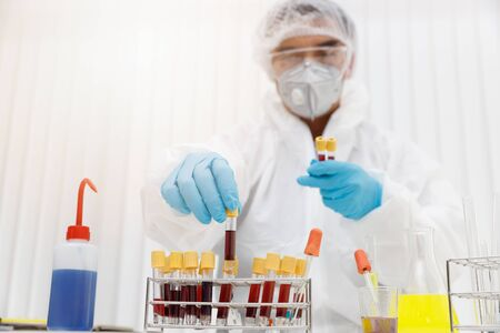 Research and development concept, Laboratory scientist researching covid-19(corona virus) vacine at lab.