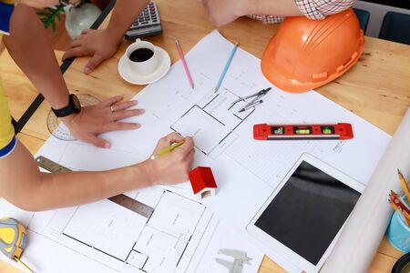 Engineer and Architect concept, Engineer Architects  and Interior designer office team working with blueprints
