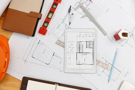 Engineer and Architect concept, Top view of Interior designer desk with blueprint Standard-Bild