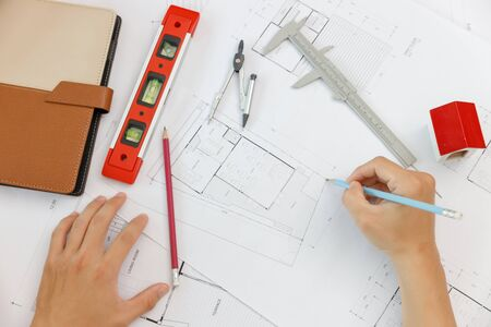 Engineer and Architect concept, Top view of Engineer Architects  and Interior designer office team working with blueprints