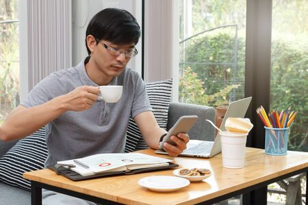 Work from home,Businessman working remotely from home. Using computer. Distance learning online education and work