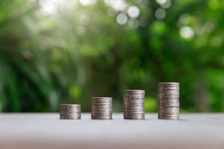 Property investment and house mortgage financial concept, Coin stack on green background. Standard-Bild