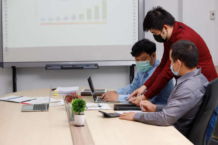New normal and Social distance conceptual, Employee wearing medical facial mask working in office.
