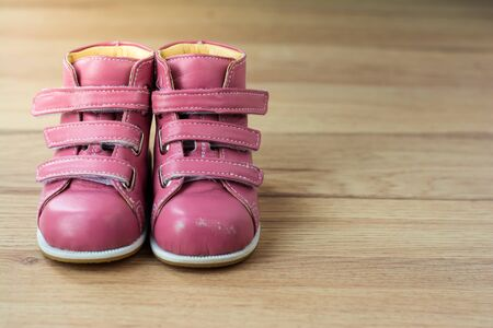 Pink Kids Shoes on wood background,Childrens leather boots