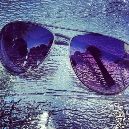 reflective: A pair of sunglasses Stock Photo