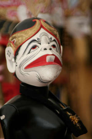 The character of Semar in the form of wayang golek is made of wood which is one of Javanese traditional arts. Stock Photo
