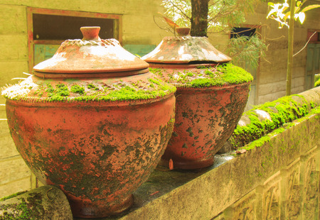 earthen: Earthen jar on the temple wall - Thailand