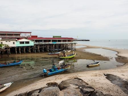 海辺で泥の小さな漁船など 写真素材