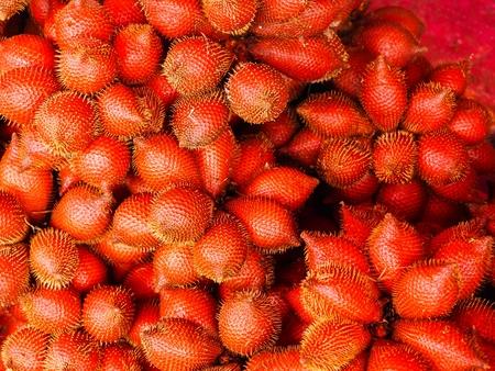 Tropical fruit, red crust like snake skin. 写真素材