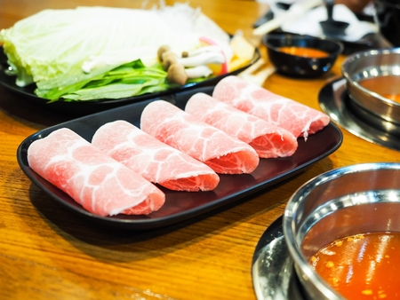 dish of thinly sliced meat and vegetables boiled in water 写真素材