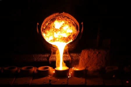 slag: Foundry - molten metal poured from ladle for casting