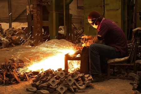 Industrial welding on steel in factory