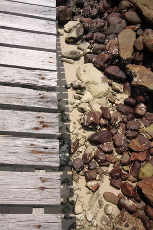Wood bridge and stone in the sand