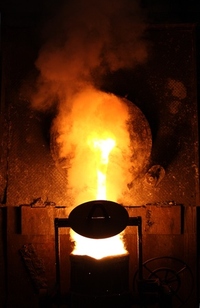 Liquid metal from casting ladle  Ferrous metallurgy  photo