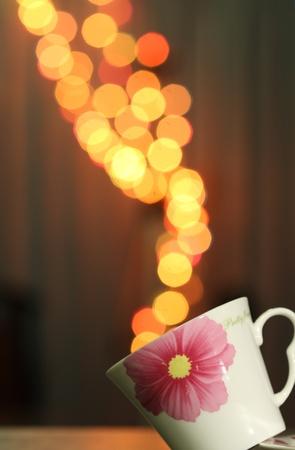 Smoke of Coffee bokeh in the white cup  Stock Photo