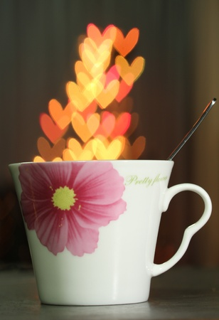 Heart bokeh in the white cup  Stock Photo