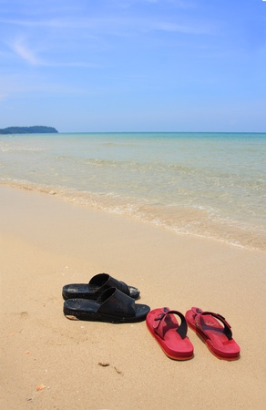 Two shoes on the beach photo