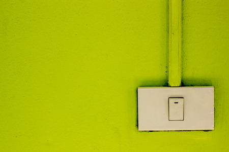 switches: Light switches on the green wall