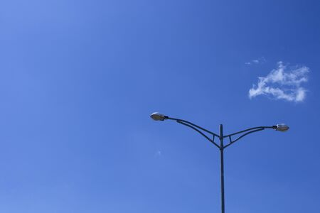 Electricity post stands alone (Street Lights) against the blue sky with clouds. copy space. Imagens