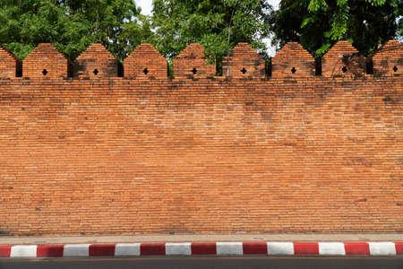 Walls by red bricks, street sidewalls,Walls by red bricks, street side walls. Stock Photo