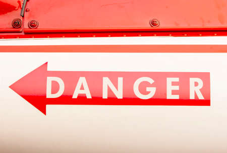 The arrow indicates danger On the shiny metal surface. Stock Photo
