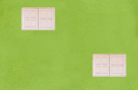 Green walls, 2-story white windows (different levels). Stock Photo