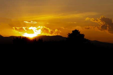 Natural Sunset Sunrise Over Field And Dark Ground. Stock Photo
