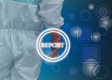 PPE coverall suit on the background of technology background And report button. Stock Photo