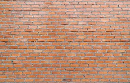 Large brick wall of red color, wide panorama.