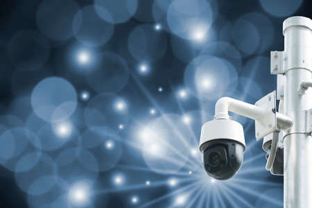 Modern surveillance cameras in bokeh, blurred background, the concept of surveillance and tracking.