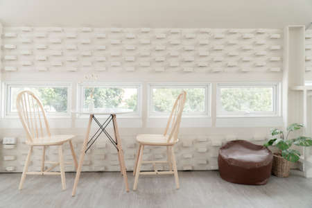 Set Of White Wooden Vintage Chairs in white decorative tones. Stock Photo