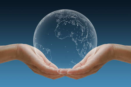 Hand cradle the globe Concept for the environment. Stock Photo