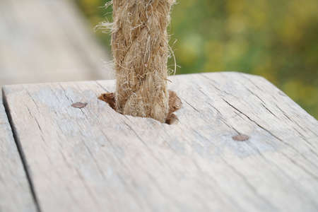 Wooden board with a rough texture and a rope Stock Photo