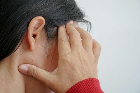 Elderly women with migraine pain Stock Photo
