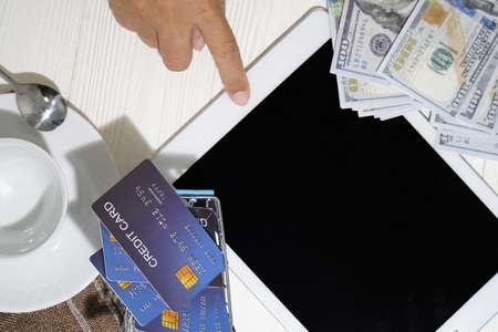 Tablet, credit card and bankroll. Stock Photo