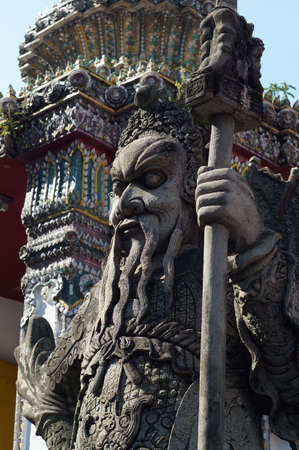 The chinese warrior statue in fron of the gate at Wap Pho,Bangkok, Thailand photo