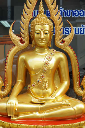 The gold buddha in sitting action in Bangkok, Thailand photo