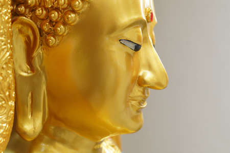 The side of face of gold buddha in Bangkok, Thailand Stock Photo - 18107385