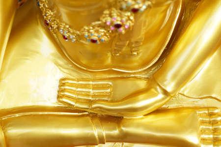 The hand and leg of gold buddha in Bangkok, Thailand Stock Photo - 18107393
