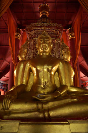 The three sitting of gold buddha in peace place Stock Photo - 18652463