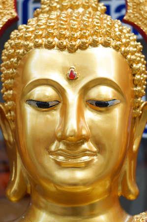 The close up face of gold buddha at Bangkok, Thailand Stock Photo - 18652447